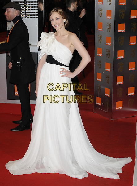 VERA FARMIGA.in Marchesa.Arrivals at the Orange British Academy Film Awards 2010 at the Royal Opera House, Covent Garden, London, England, UK, .21st February 2010.BAFTA BAFTAs full length black waistband white one shoulder dress gown long maxi hand on hip origami corsage silk chiffon .CAP/CAN.©Can Nguyen/Capital Pictures