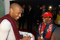 Thierry Henry (14) of the New York Red Bulls  talks with Soike Lee after the match. The New York Red Bulls defeated the Colorado Rapids 4-1 during a Major League Soccer (MLS) match at Red Bull Arena in Harrison, NJ, on March 25, 2012.