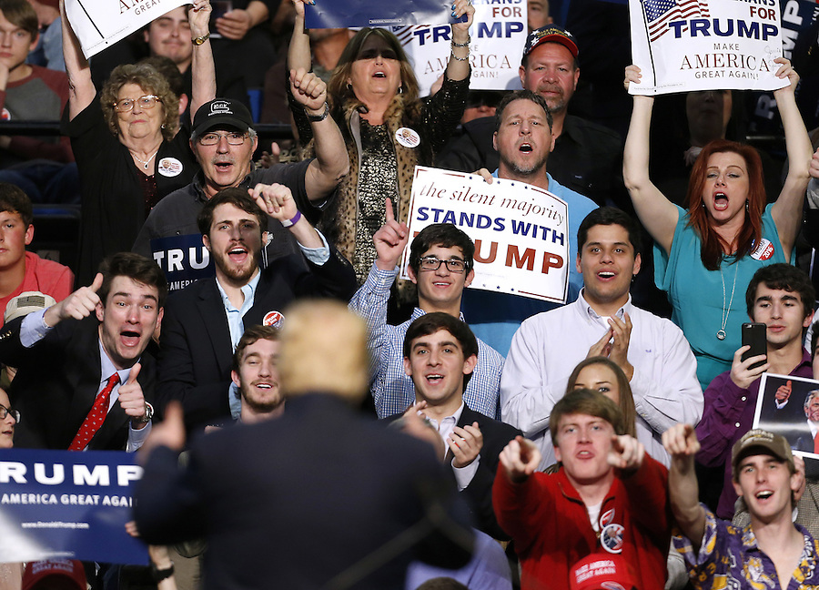 Supporters of Republican U.S. presidential candidate Donald Trump cheers during a rally in Baton Rouge in Baton Rouge, Louisiana February 11, 2016. REUTERS/Jonathan Bachman