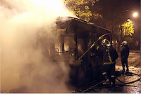 Pictured: A public city bus which had been set ablaze by protesters after being doused by fire extinguishing foam Tuesday 02 December 2014<br />