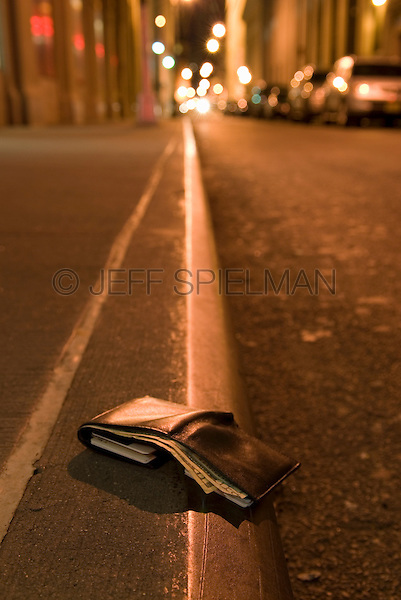 AVAILABLE FROM PLAINPICTURE FOR COMMERCIAL AND EDITORIAL LICENSING.  Please go to www.plainpicture.com and search for image # p5690176.<br /> <br /> Lost Wallet on an Empty Street in Lower Manhattan's Financial District, New York City, New York State, USA