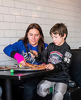 MMA fighter Cat Zingano (cq) eats lunch with her son, Brayden Zingano (cq, age 8) after a football game in Parker, Colorado, Saturday, November 8, 2014. In 2013, Zingano became the first woman to win a UFC fight by technical knockout and is currently the number three ranked pound-for-pound female MMA fighter in the world.<br /> <br /> Photo by Matt Nager