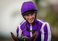 DEL MAR, CA - NOVEMBER 03: Ryan Moore smiles after winning the Breeders' Cup Juvenile Turf at Del Mar Thoroughbred Club on November 03, 2017 in Del Mar, California. (Photo by Alex Evers/Eclipse Sportswire/Breeders Cup)