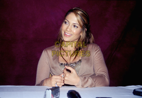 JENNIFER LOPEZ.half length, half-length, tape recorders, light brown top .www.capitalpictures.com.sales@capitalpictures.com.© Capital Pictures