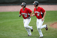 May 2, 2010:  Catcher Allan de San Miguel of the Rochester Red Wings with Dustin Martin (16) after hitting a home run during a game vs. the Durham Bulls at Frontier Field in Rochester, NY.  Rochester defeated Durham in extra innings by the score of 7-6.  Photo By Mike Janes/Four Seam Images
