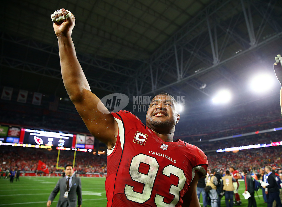 Jan 16, 2016; Glendale, AZ, USA; Arizona Cardinals defensive end Calais Campbell (93) reacts as he celebrates following the game against the Green Bay Packers during an NFC Divisional round playoff game at University of Phoenix Stadium. Mandatory Credit: Mark J. Rebilas-USA TODAY Sports