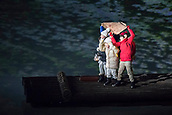 9th February 2018, Pyeongchang, South Korea; 2018 Winter Olympic Games; PyeongChang Olympic Stadium; Young children on a raft covers their heads with a map during the Opening Ceremony