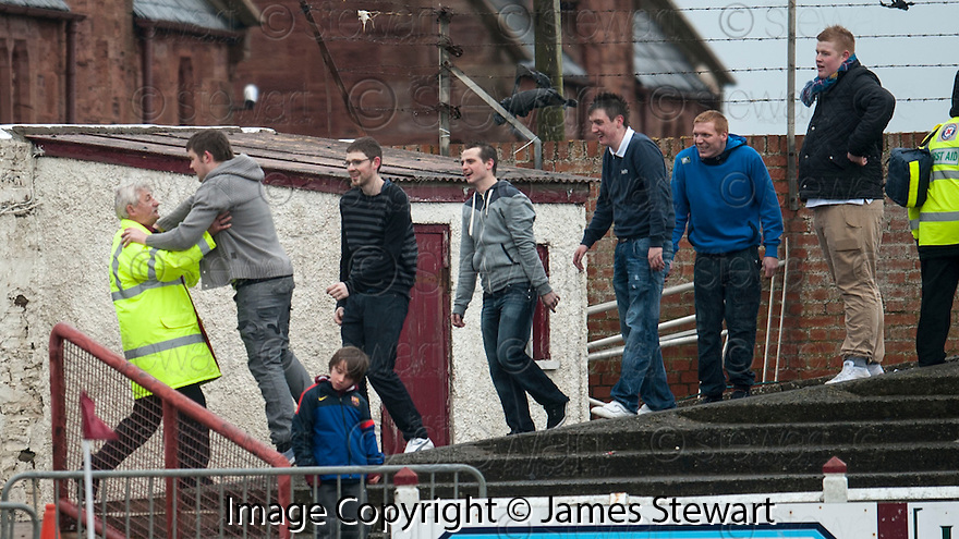 Queen of the South fans' conga is brought to an abrupt end by an Arbroath steward.