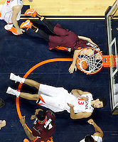 Virginia forward Anthony Gill (13) is fouled by Virginia Tech guard Devin Wilson (11) during the game Saturday in Charlottesville, VA. Virginia won 65-45.