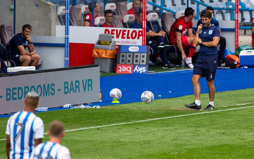 Huddersfield Town manager Danny Cowley kicks a ball<br /> <br /> Photographer Alex Dodd/CameraSport<br /> <br /> The EFL Sky Bet Championship - Huddersfield Town v Wigan Athletic - Saturday 20th June 2020 - John Smith's Stadium - Huddersfield <br /> <br /> World Copyright © 2020 CameraSport. All rights reserved. 43 Linden Ave. Countesthorpe. Leicester. England. LE8 5PG - Tel: +44 (0) 116 277 4147 - admin@camerasport.com - www.camerasport.com