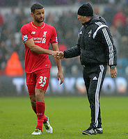 Swansea head coach Francesco Guidolin (R) greets Kevin Stewart of Liverpool after the Barclays Premier League match between Swansea City and Liverpool at the Liberty Stadium, Swansea on Sunday May 1st 2016