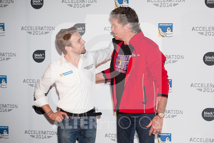 US actor David Hasselhoff (R) and driver Dani Clos pose in Acceleration 2014 festival presentation at Hotel Room Mate Oscar in Madrid, Spain. March 25, 2014. (ALTERPHOTOS/Victor Blanco)