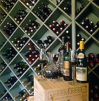 Detail of contemporary wine storage with a couple of open bottles from a local South African vineyard