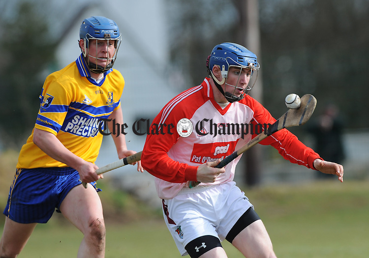 Sam O Sullivan of Sixmilebridge in action against Donal Tuohy of Crusheen during their U-21 A hurling quarter final at Clarecastle. Photograph  by John Kelly.