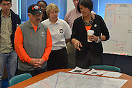 April 26, 2013  (Baltimore, Maryland)  Baltimore Mayor Stephanie Rawlings-Blake (l) shows San Francisco Mayor Edwin M. Lee (r) a crime data map at a Baltimore police station. Mayor Lee visited Baltimore for a day of community service. (Photo by Don Baxter/Media Images International)