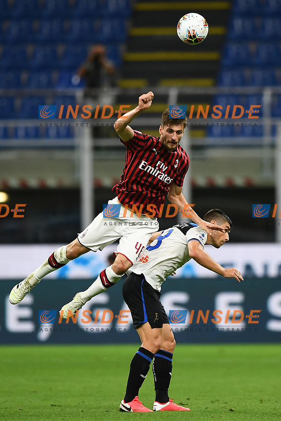 Matteo Gabbia of AC Milan and Ruslan Malinovskyi of Atalanta BC compete for the ball during the Serie A football match between AC Milan and Atalanta BC at stadio Giuseppe Meazza in Milano ( Italy ), July 24th, 2020. Play resumes behind closed doors following the outbreak of the coronavirus disease. <br /> Photo Image Sport / Insidefoto