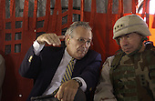 United States Secretary of Defense Donald H. Rumsfeld and Lieutenant General Ricardo Sanchez reflect on the past weeks events in Iraq while flying en route to Camp Victory on an United States Army CH-47E Chinook helicopter on May 13, 2004.  Rumsfeld traveled to Iraq to visit the troops in Baghdad and Abu Ghraib.  <br /> Mandatory Credit: Jerry Morrison / DoD via CNP