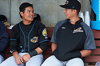 Akron RubberDucks shortstop Yu-Cheng Chang (left) and pitcher Luis Lugo (right) in the dugout before a game against the Binghamton Rumble Ponies on May 12, 2017 at NYSEG Stadium in Binghamton, New York.  Akron defeated Binghamton 5-1.  (Mike Janes/Four Seam Images)