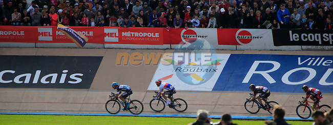 The lead group of riders enter the famous Roubaix Velodrome at the end of the 113th edition of the Paris-Roubaix 2015 cycle race held over the cobbled roads of Northern France. 12th April 2015.<br /> Photo: Eoin Clarke www.newsfile.ie