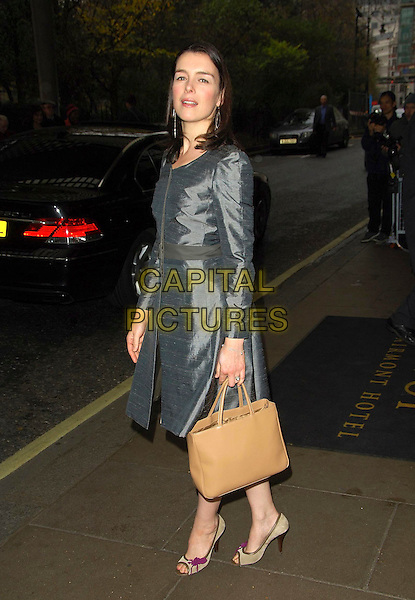 OLIVIA WILLIAMS.Evening Standard Theatre Awards, Lancaster room, The Savoy Hotel, London, England..November 27th, 2007.full length beige bag purse silver grey gray dress .CAP/CAS.©Bob Cass/Capital Pictures.