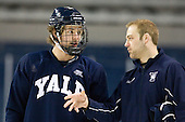 Gus Young (Yale - 4), Eric Lind (Yale - Assistant Coach) - The Yale University Bulldogs took part in a morning skate on Friday, March 25, 2011, during the East Regional at Webster Bank Arena at Harbor Yard in Bridgeport, Connecticut.