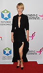 Amber Valetta at the Pathway To The Cure for Breast Cancer A fundraiser benefiting Susan G. Komen held at private hangar at Santa Monica Airport Los Angeles, CA. June 11, 2014.