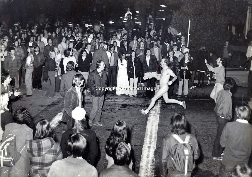 Streaking craze hits University of California at Berkeley, California. Crowd at the corner of Channing Way & College Ave. cheer as the student streaker passes. (photo 1974 by Ron  Riesterer)