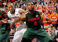 Miami forward Raphael Akpejiori (4) and Virginia forward Akil Mitchell (25) during an NCAA basketball game Saturday Feb, 24, 2014 in Charlottesville, VA. Virginia defeated Miami 65-40.