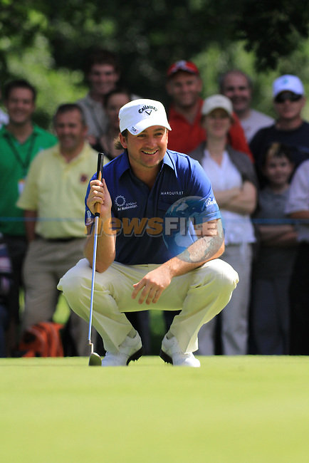 Graeme McDowell laughs out after a baloon pops as he went to take his putt on the second green during the first round of the 3 Irish Open, at the Killarney Golf and Fishing Club, Killarney, Ireland.Picture Fran Caffrey/www.golffile.ie.