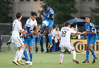 Ike Opara (6) heads down the ball against Juan Manuel Pena in the mix. The San Jose Earthquakes tied DC United 1-1 at Buck Shaw Stadium in Santa Clara, California on July 3rd, 2010.