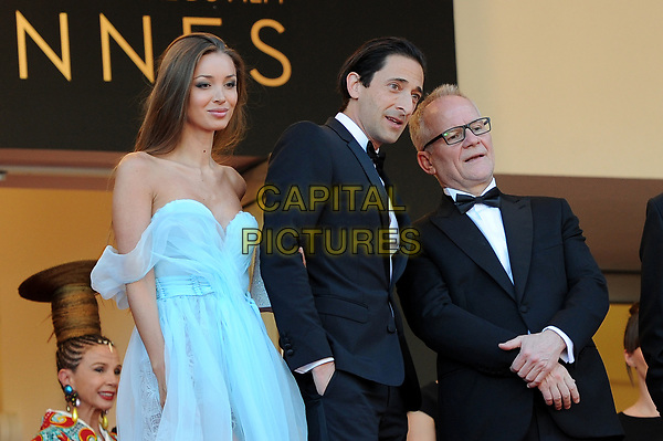 Adrien Brody with his girlfriend Lara Lieto and Director of the Cannes Film Festival Thierry Fremaux at the Opening Movie &acute;Les Fantomes d Ismael`  screening during The 70th Annual Cannes Film Festival on May 17, 2017 in Cannes, France.<br /> CAP/LAF<br /> &copy;Lafitte/Capital Pictures
