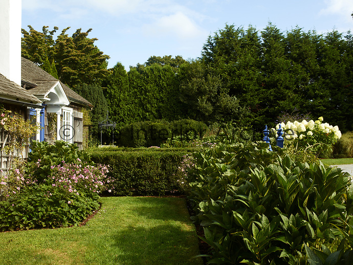 To the rear of the cottage is a pretty garden with a lawn, hedging and flowering shrubs.