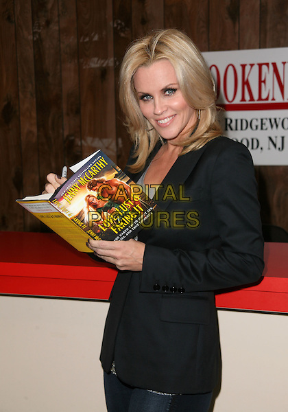 "JENNY McCARTHY.Jenny McCarthy signs copies of her new book ""Love, Lust and Faking It"" at Book-Ends Book Store, Ridgewood, New Jersey, USA, 29th September 2010..half length black jacket book silver sequined sequin top .CAP/ADM/PZ.©Paul Zimmerman/AdMedia/Capital Pictures."