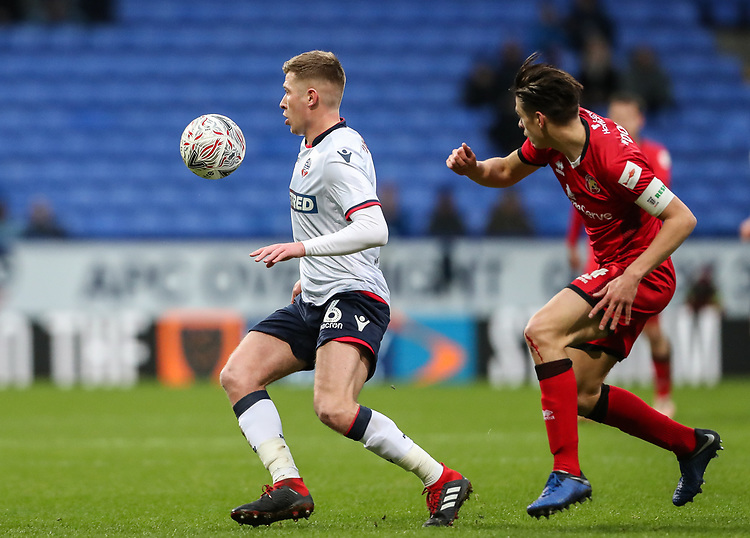 Bolton Wanderers' Josh Vela competing with Walsall's George Dobson <br /> <br /> Photographer Andrew Kearns/CameraSport<br /> <br /> Emirates FA Cup Third Round - Bolton Wanderers v Walsall - Saturday 5th January 2019 - University of Bolton Stadium - Bolton<br />  <br /> World Copyright © 2019 CameraSport. All rights reserved. 43 Linden Ave. Countesthorpe. Leicester. England. LE8 5PG - Tel: +44 (0) 116 277 4147 - admin@camerasport.com - www.camerasport.com