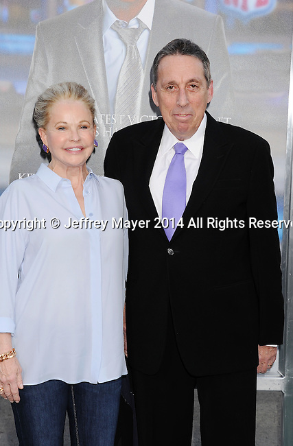 WESTWOOD, CA- APRIL 07: Director Ivan Reitman (R) and wife Genevieve Robert attend the Los Angeles premiere of 'Draft Day' at the Regency Village Theatre on April 7, 2014 in Westwood, California.