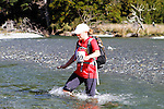 NELSON LAKES, NEW ZEALAND - APRIL 18:  Charlotte Hill crosses the Travers River during the 2015 Alpine Lodge Loop The Lake trail run at Lake Rotoiti on April 18 16, 2015 in Nelson, New Zealand. (Photo by Marc Palmano/Shuttersport Limited)