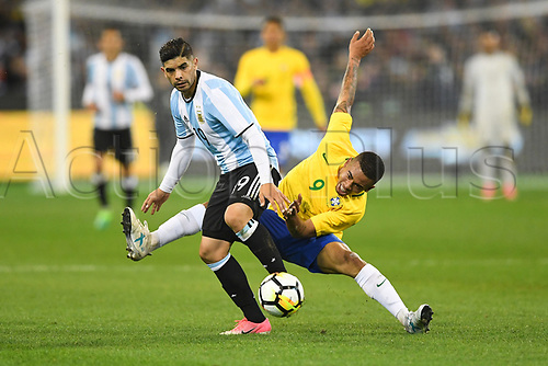 June 9th 2017, Melbourne Cricket Ground, Melbourne, Australia; International Football Friendly; Brazil versus Argentina; Ever Banega of Argentina keeps his composure as Gabriel Jesus of Brazil falls to the pitch