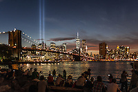 A crowd of some 100 people gathered at the Brooklyn Bridge Park in Dumbo to spectate and phptograph the Tribute in Light memorial on the 13th anniversary of 9/11. Sept. 11, 2014. New York, USA.