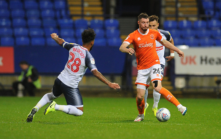 Blackpool's James Husband under pressure from Bolton Wanderers' Liam Bridcutt<br /> <br /> Photographer Kevin Barnes/CameraSport<br /> <br /> The EFL Sky Bet League One - Bolton Wanderers v Blackpool - Monday 7th October 2019 - University of Bolton Stadium - Bolton<br /> <br /> World Copyright © 2019 CameraSport. All rights reserved. 43 Linden Ave. Countesthorpe. Leicester. England. LE8 5PG - Tel: +44 (0) 116 277 4147 - admin@camerasport.com - www.camerasport.com
