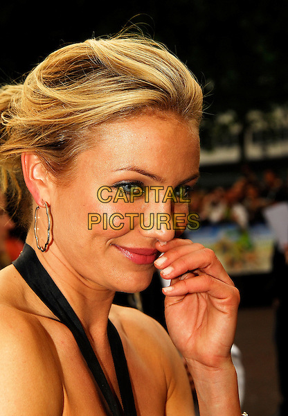 "CAMERON DIAZ.Attending the UK Premiere of ""Shrek The Third"",.Odeon Leicester Square, London, England,.June 11th 2007..portrait headshot hand touching nose funny.CAP/IA.©Ian Allis/Capital Pictures"