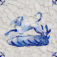 Dog Delft, a hand-cut cut jewel glass mosaic, shown in  Opal Sea Glass™ with jewel glass Lapis Lazuli, Iolite, and Covelite, is part of the Sea Glass™ Collection by New Ravenna.