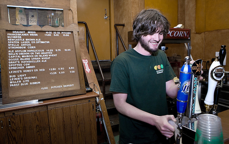 A student works the taps at Der Stiftskeller bar, at the Memorial Union Terrace.