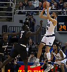 Nevada forward Caleb Martin (10) shoots over San Diego State forward Aguek Arop (3) in the first half of an NCAA college basketball game in Reno, Nev., Saturday, March 9, 2019. (AP Photo/Tom R. Smedes)
