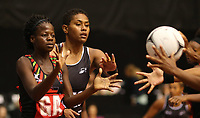 22.02.2018 Fiji's Episake Kahatoka and Malawi's Sindi Simtowe in action during the Fiji v Malawi Taini Jamison Trophy netball match at the North Shore Events Centre in Auckland. Mandatory Photo Credit ©Michael Bradley.
