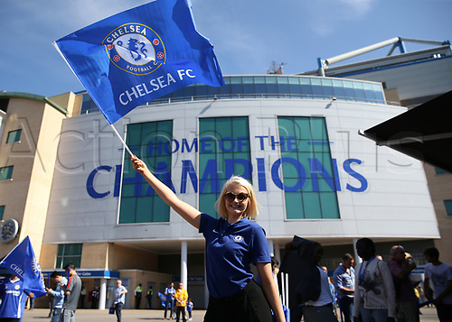 27th August 2017, Stamford Bridge, London, England; EPL Premier League football, Chelsea versus Everton; Chelsea fan waving Chelsea flag posing outside Stamford Bridge before kick off