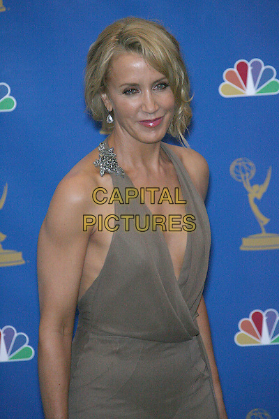 FELICITY HUFFMAN.Press Room - 58th Annual Primetime Emmy Awards held at the Shrine Auditorium, Los Angeles, California, USA, .27 August 2006..emmys half length grey brown mushroom dress low cut halterneck.Ref: ADM/ZL.www.capitalpictures.com.sales@capitalpictures.com.©Zach Lipp/AdMedia/Capital Pictures.