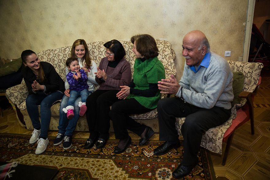 Syrian Armenian family who fled Aleppo are now living in Yerevan. A local Armenian woman volunteers to help them with issues of integration. Volunteer Lia Tevosyan meets with the Ohannesian family who migrated from Syrian. Lia participates in the UNHCR-KASA joint project &quot;Adopt a Family which brings together Armenian volunteers and Syrian-Armenian refugees as they settle in Armenia. <br /> Family members are: <br /> Father: Artin Ohannesian(74), mother: Azatuhi Pampalian (59), their daughter: Marina Ohannesian(28), her child Shushi Bardi Palgeorgian(2) and Marina's mother in law - Shushanik Narkozian; their son: Raffi Ohannesian<br /> <br /> ,