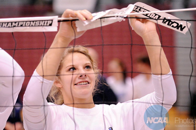03 DEC 2011:  Cassie Weaver (9) of Concordia University St. Paul celebrates the Golden Bears victory over Cal State San Bernardino by cutting down the net during the Division II Women's Volleyball Championship held at Coussoulis Arena on the Cal State San Bernardino campus in San Bernardino, Ca. Concordia St. Paul defeated Cal State San Bernardino 3-0 to win the national title. Matt Brown/ NCAA Photos