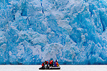 Tourists exploring  Dawes Glacier in Alaska's Inside Passage. This area is part of the Tracy Arm-Fords Terror Wilderness in the Tongass National Forest