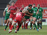 Connacht's Jake Heenan is tackled by Scarlets' Jordan Williams<br /> <br /> Rugby - Scarlets V Connacht - Guinness Pro12 - Sunday 15th Febuary 2015 - Parc-y-Scarlets - Llanelli<br /> <br /> &copy; www.sportingwales.com- PLEASE CREDIT IAN COOK